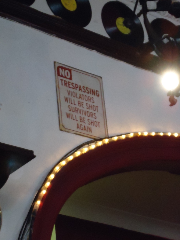 """NO TRESPASSING Violators wil be shot Survivors will be shot again."" - Black Rose Pub"